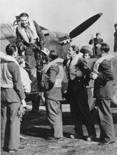Sgt Alois Dvořák is welcomed by pilots of No 310 Squadron RAF at RAF Duxford after return from a patrol in October 1940, in which he damaged an Me 109. The 24-year-old Czech had been posted in on 15 October, with F/L Jerrard Jefferies (first left) leading B Flight since 10 July,. Both pilots bellied their Hurricane Mk I fighters at RAF Debden, unhurt, on 5 November after combat with enemy fighters over the Thames Estuary.
