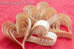 Glittered Book Page Heart Garland via TheKimSixFix.com