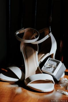 Adorable classic wedding accessories - strapped white heels with pearl earrings {Earth Below Photo}
