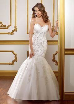 Style 1821 - Embroidery on english net with organza.  Colors Available: White/Silver, Ivory/Silver.