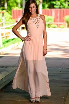 "Go ahead and clutch those pearls, you chic diva! We love a little drama in our maxis and this peach number delivers a stellar performance! With a beaded neckline that craves the spotlight and an open back fit for a stage's biggest star, this town gown is sure to bring down the house whenever you wear it!   Features a short skirt lining, hidden back zipper and two hook clasps. Fits true to size. Miranda is wearing the small. Length from neckline to hem: S- 58"", M- 58.5"", L- 59"""
