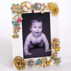 Jeweled picture frame. Perfect if you a a ton of costume jewelry that you don't use anymore or ones that are missing their pair.