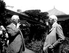 George Eastman, the founder of modern photography, and Thomas A. Edison, inventor of the motion picture camera, talk in the Eastman House gardens in Rochester in 1928. Nearly four decades earlier, Eastman had supplied the first strip of film for Edisons experiment. Credit: Eastman Kodak Co.