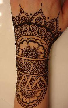 Simple wrist design: flower, swirls, bands