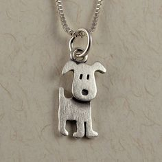 I love this... Puppy necklace by StickManJewelry on Etsy, $30.00