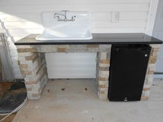 outdoor sink area with mini refrig. built with Air Stones from Lowe's. outdoor sink.