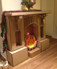 Funny pictures about Epic Cardboard Fireplace. Oh, and cool pics about Epic Cardboard Fireplace. Also, Epic Cardboard Fireplace photos. Christmas Fireplace, Noel Christmas, Christmas Crafts, Christmas Decorations, Fake Fireplace, Christmas Stockings, Artificial Fireplace, Christmas Program, Office Christmas