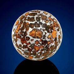 This piece of the Seymchan meteorite, which was discovered in Russia in 1967, was shaped into a sphere.   Golden gems of a mineral called olivine are embedded in iron nickel, forming a type of meteorite called a pallasite. Credit: Christie's Inc.  Visit Amazing Geologist for morw..