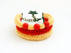 knitted bracelet in red and peach