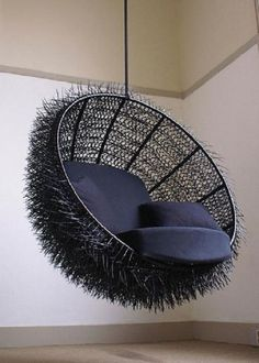 A chair decorated with black zip ties creating a sea urchin appearance.