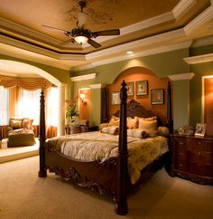 Peregrine Homes designed this Master Suite with a raised Sitting Room and a stepped ceiling with faux painting.  Peregrine Homes also designed a niche that your king size bed can fit into, giving this room a true custom look.  To see more of this house visit Sarasota custom home builder Peregrine Homes at www.peregrinecustomhomes.com