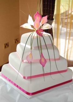 I like the shape of this cake... not necessarily the flower on top