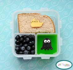 And lastly, another afternoon nutrition break bento. She got half a ham and cheese sandwich with a little cheese boat with food marker details. She got a container of blueberries for the water and a container of green jello with a fruit leather octopus with icing eyes.