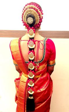 South Indian bride. Temple jewelry. Jhumkis.Red silk kanchipuram sari.Braid with fresh flowers. Tamil bride. Telugu bride. Kannada bride. Hindu bride. Malayalee bride.Kerala bride.