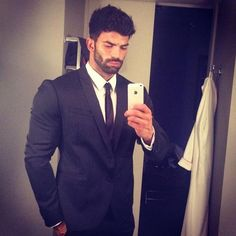 Sergi Constance in suit takes a selfie