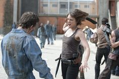 Lauren Cohan as Maggie with a machete bout to kill a walker