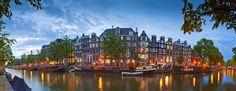 Fotobehang: Avondreflecties in het Water van Amsterdamse Huizen