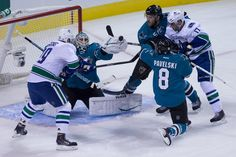 San Jose Sharks goaltender Antti Niemi snags the puck out of the air during the first period (Oct. 3, 2013).