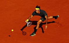 Roger Federer plays a forehand against Novak Djokovic in the semifinal at the French Open.