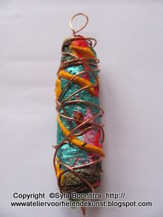 Tyvek bead, of heated and painted Tyvek (Lumiere) paint/organza and copper wire.