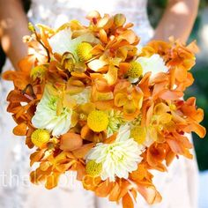 In addition to exotic mokara orchids, Melissa's vibrant bouquet was accented with yellow billy balls and white dahlias.  Like the white in between the organge (this is not the right orange), but I would want to see more green too!