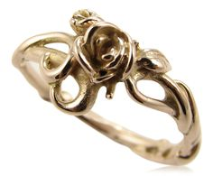 Simply a rose set amongst twisting vines and leaves, this little ring is perfect in its feminine appeal. A tiny rosebud is offset to one side. The detail goes all the way around the band, handcarved exclusively by Sarah J Christenson 14k Rose gold
