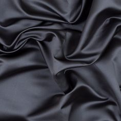 British Flint Polyester Satin A harmonious color that brings a peacefulness with it, take home this British Flint Polyester Satin. You can fill your living area with glamour just by using it for sleek and stylish pillows casings.