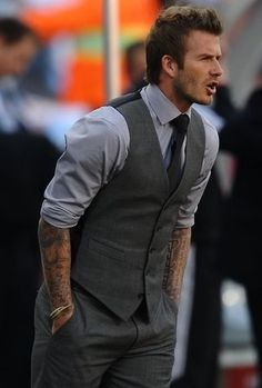 David Beckham wearing Grey Dress Shirt, Charcoal Waistcoat, Charcoal Dress Pants, and Black Tie: