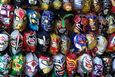 These are different Lucha Libre masks that people can buy and wear at a match.