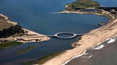 Circular Laguna Garzon Bridge, Uruguay ~ The bridge features two pedestrian walkways to take in the view. While the raft crossing previously only allowed two cars to cross the lagoon, this new circular bridge allows 1,000 vehicles to pass at a time.