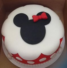 Minnie Mouse. One of the easiest cakes ever. I got the idea from pinterest. It looks better in person. I used fondant and modeling chocolate. www.qcakes.com