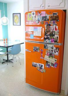Aqua and orange kitchen.