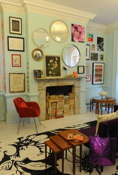 These walls are amazing. I adore how a few vintage frames and mirrors could create an amazing work of art. Sara's stairs these would be fun to find