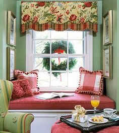 Such a lovely color scheme was used in this nook, with florals, plaids and stripes playing against each other--English Country style!  Note the framed prints on the wall...