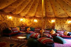 Draping like a tent with soft lighting and low seating