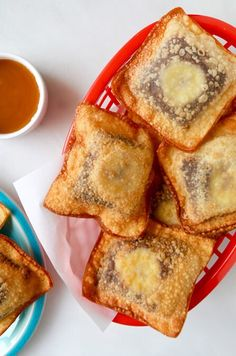 Sliced bananas add a fruity twist to the ultimate quick and easy recipe for chocolate wontons dunked in caramel sauce.
