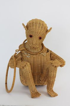 Hey, I found this really awesome Etsy listing at https://www.etsy.com/listing/189521702/rare-1950s-figural-wicker-monkey-purse