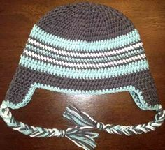 In any #crochet colors you wish (although the blue and silver is beautiful), you can work up this cute winter hat. An Adult Braided Ear Flap Hat is great for keep your head and ears warm during winter.
