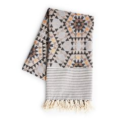 House of Rym Go Undercover blanket in rose and grey with geometric blanket design. Wrap yourself in beautiful blankets and throws. 100% cotton.