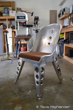 Aluminum sheet metal, buck riveted, aviation inspired chair. industrial style furniture