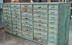 Love the color and drawers - I would be in HEAVEN if I could get my little fingers on one of these!