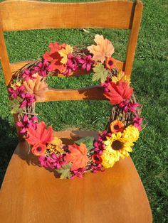 Grapevine wreath adorned with brilliant Fall colors ... red, dark green, orange, yellow & deep purple ~ beautiful for your Fall decorating!