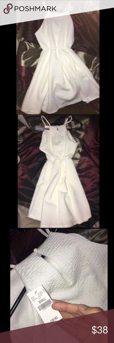White quilted skater dress Brand new with tags! Please take it off my hands! It's HALF PRICE for a NEW dress🎁🎉 ⭐️Price is firm⭐️ Wet Seal Dresses Asymmetrical
