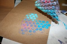 Painting with Bubble Wrap. Would make super cute gift wrap or just a cool stamp