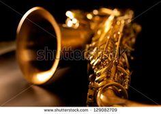 Tenor sax golden saxophone macro with selective focus on black - stock photo