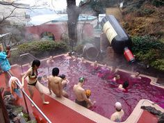 A spa in Japan where you bathe in wine- & there's a HUGE wine bottle that pours it into the hot tub!