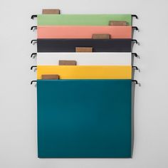 Whether at your home office or for your desk at work, let the Solid Hanging File Folders from Hearth & Hand™ with Magnolia keep your documents neat and organized. This pack of six hanging folders features various colors — blue, yellow, white, black, pink and green — with labels at the top of each folder, allowing you to easily identify the contents inside. Use them with a gold file stand or keep them inside the file box of your desk drawer for a quick and effi...