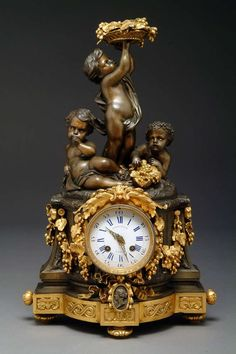 Very fine century French gilt-bronze figural mantel clock by Raingo Freres, Retailed by Jacobs & Lucas. The movement stamped: Raingo Freres Paris. The dial inscribed: Jacobas & Lucas A Paris. Raingo Freres began business in the early Mantel Clocks, Old Clocks, Clock Decor, Antique Clocks, Vintage Clocks, Antique Watches, Vintage Watches, Plywood Furniture, Antique Furniture