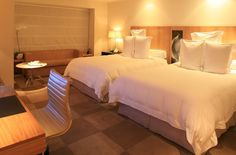 Deluxe Twin Room. Hotel Emiliano, São Paulo. Setting the pace for luxury travel in Brazil. By Hotelied.