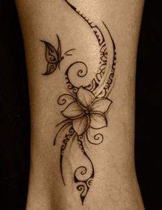 Un tatouage polynésien sur l'avant bras